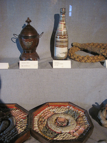Sailors' valentines, guano bottle art, and a coconut shell decorative dish at the Maritime Museum, Halifax. Photo by the author.