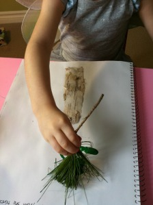 Kid using a pine twig brush, photo from Rockabye Butterfly, click for link