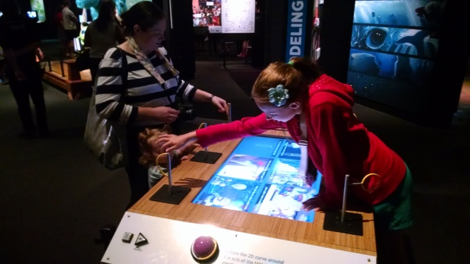 This was one of the interactives where I thought the handles for controlling the interactive were more interesting than the activity itself. Each handle was the same shape as the line on the screen which one rotated to make a 3D shape. Very clever!